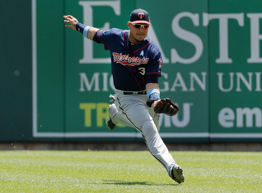 . Minnesota Twins right fielder Oswaldo Arcia catches a Detroit Tigers\' Nick Castellanos one-run sacrifice fly in the second inning of a baseball game in Detroit, Sunday, June 15, 2014. (AP Photo/Paul Sancya)