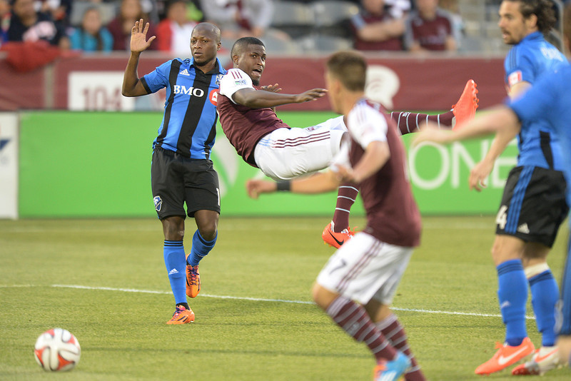 . Colorado was awarded a penalty kick after Montreal midfielder Sanna Nyassi (11) was whistled for bringing down Colorado forward Edson Buddle in the first half. The Colorado Rapids hosted the Montreal Impact Saturday night, May 24, 2014. (Photo by Karl Gehring/The Denver Post)