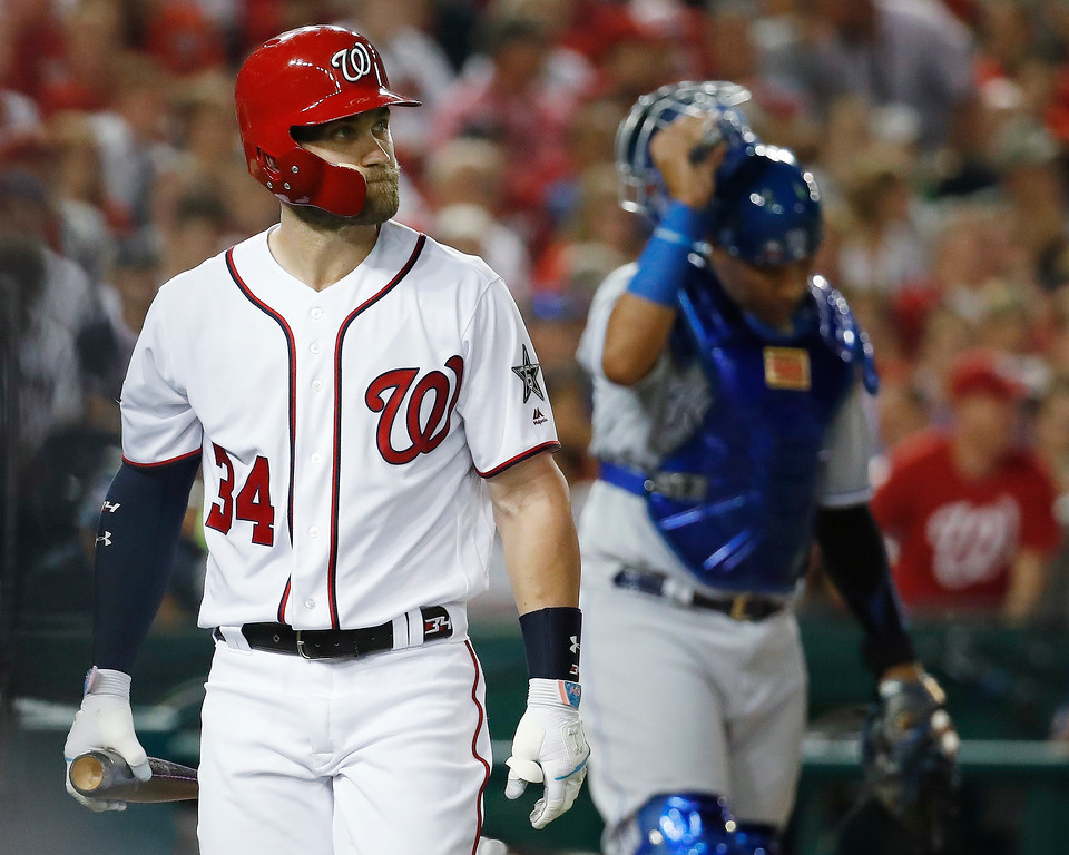 . Washington Nationals outfielder Bryce Harper (34) walks off the field after striking out in the fourth inning of the Major League Baseball All-star Game, Tuesday, July 17, 2018 in Washington. (AP Photo/Alex Brandon)