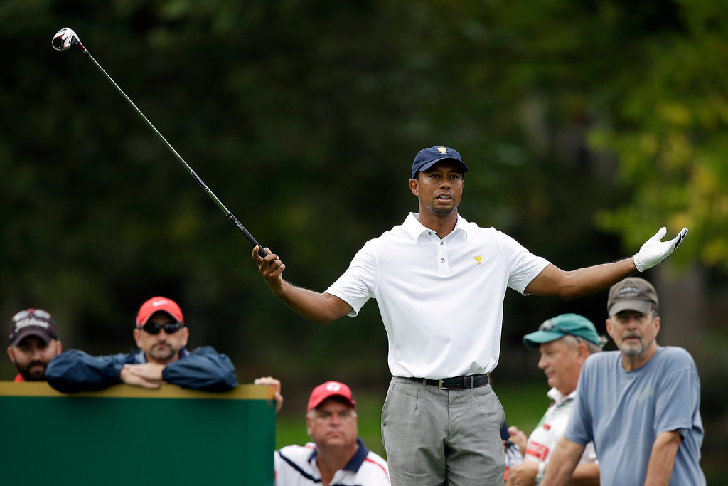 . United States team player Tiger Woods reacts before teeing off on the 18th hole during the single matches at the Presidents Cup golf tournament at Muirfield Village Golf Club Sunday, Oct. 6, 2013, in Dublin, Ohio. (AP Photo/Darron Cummings)