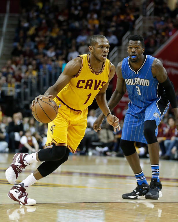 . Cleveland Cavaliers\' James Jones (1) drives past Orlando Magic\'s Dewayne Dedmon (3) in the second half of an NBA basketball game Saturday, Jan. 2, 2016, in Cleveland. (AP Photo/Tony Dejak)
