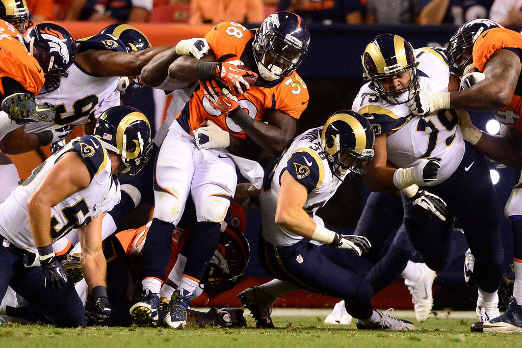 . DENVER, CO - AUGUST 24: Montee Ball (38) of the Denver Broncos gets stuffed by the St. Louis Rams defense during the second half of action of an NFL preseason game at Sports Authority Field at Mile High on August 24, 2013. This is the third game of the preseason for the Broncos. (Photo by AAron Ontiveroz/The Denver Post)