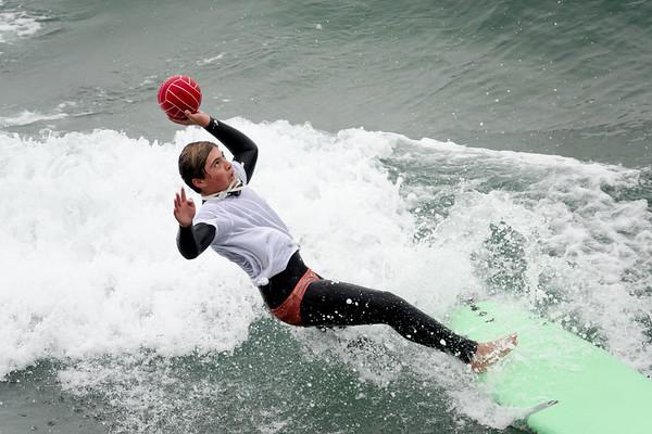 Surfing in costume in Manhattan Beach