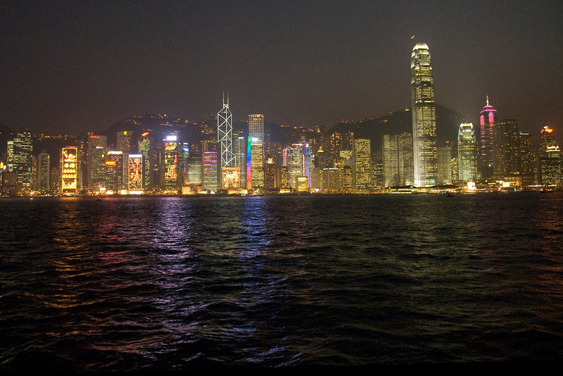 Reflecting lights on the water from the Hong Kong skyline at night