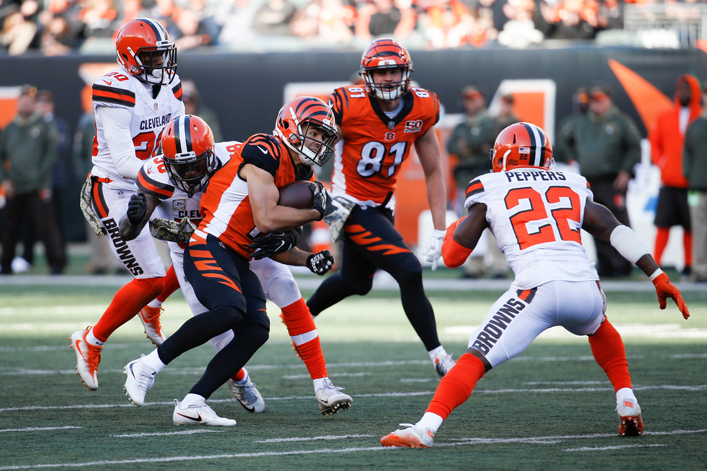 . Cincinnati Bengals wide receiver Alex Erickson (12) runs the ball against Cleveland Browns outside linebacker Christian Kirksey (58) in the second half of an NFL football game, Sunday, Nov. 26, 2017, in Cincinnati. (AP Photo/Frank Victores)
