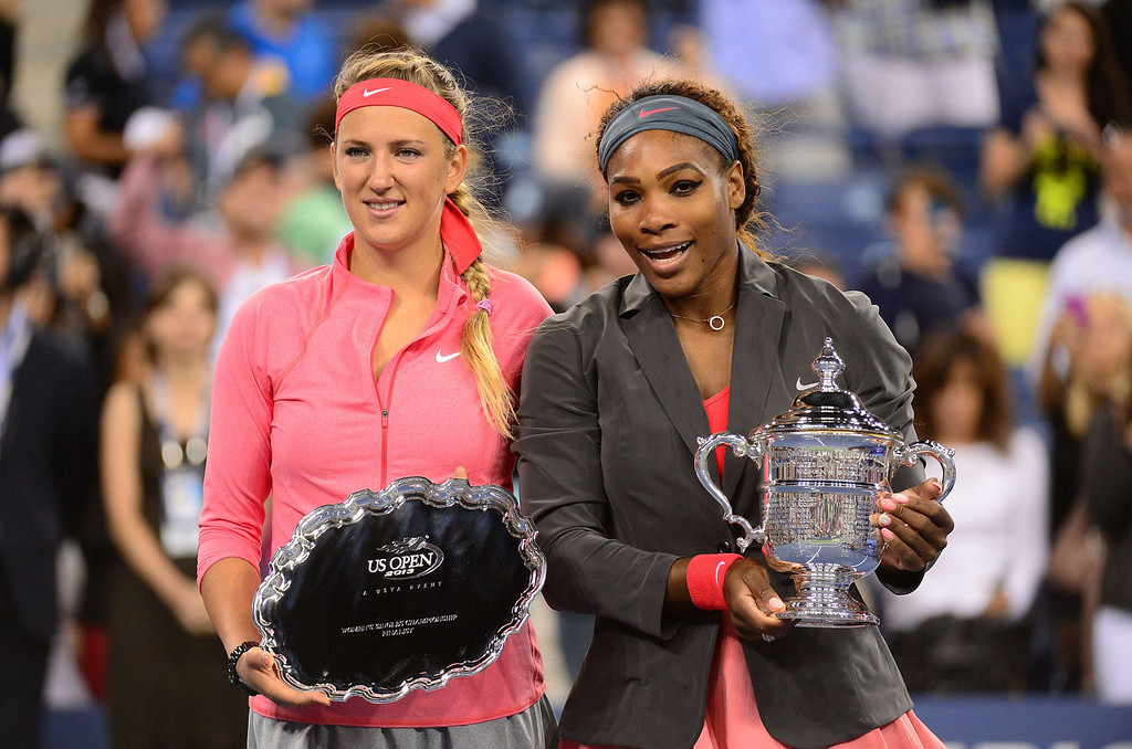 . US tennis player Serena Williams (R) holds her winning trophy while posing with Belarus Victoria Azarenka (L) during the 2013 US Open women\'s final at the USTA Billie Jean King National Tennis Center in New York on September 8, 2013.   EMMANUEL DUNAND/AFP/Getty Images