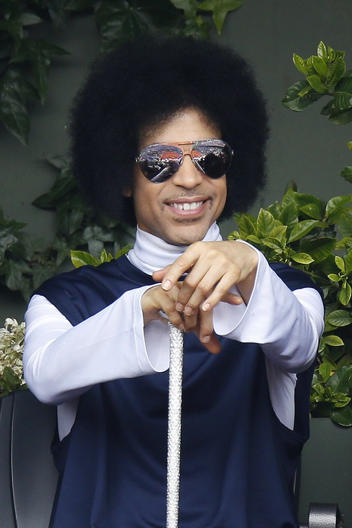 . US singer Prince attends the French tennis Open round of sixteen match between Spain\'s Rafael Nadal and Serbia\'s Dusan Lajovic at the Roland Garros stadium in Paris on June 2, 2014.    (Photo by KENZO TRIBOUILLARD/AFP/Getty Images)