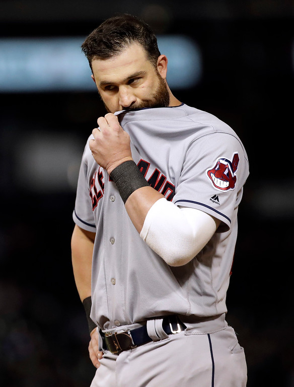 . Cleveland Indians\' Jason Kipnis wipes his face during the ninth inning of the team\'s baseball game against the Chicago White Sox, Friday, Aug. 10, 2018, in Chicago. The White Sox won 1-0. (AP Photo/Nam Y. Huh)