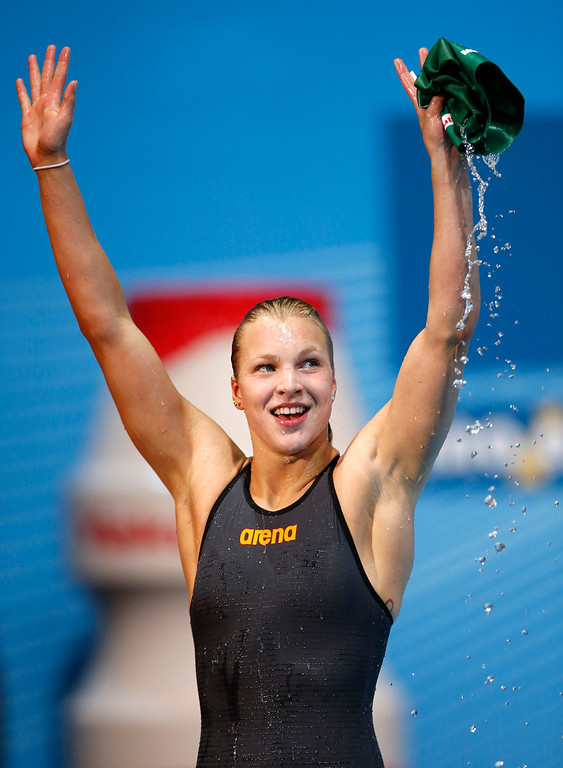 . Lithuania\'s Ruta Meilutyte reacts after winning a Women\'s 50m breaststroke semifinal in a new world record time of 29.48 at the FINA Swimming World Championships in Barcelona, Spain, Saturday, Aug. 3, 2013.   (AP Photo/Michael Sohn)