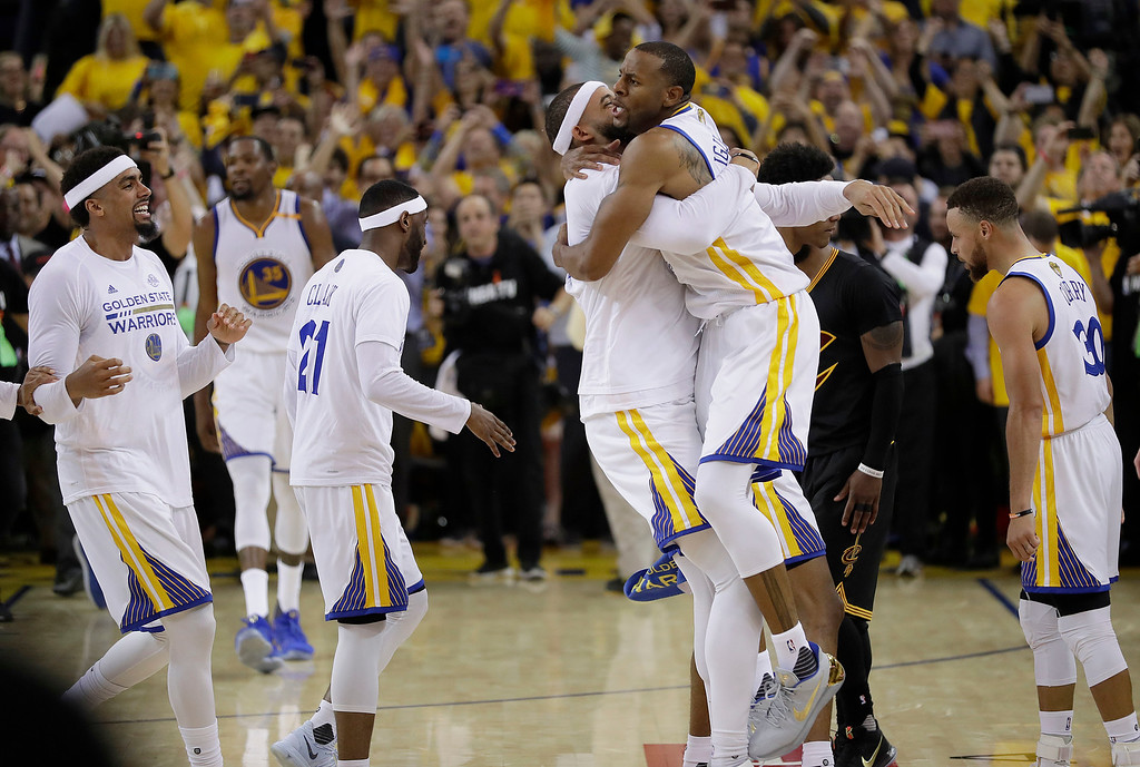 . Golden State Warriors players celebrate after beating the Cleveland Cavaliers in Game 5 of basketball\'s NBA Finals in Oakland, Calif., Monday, June 12, 2017. The Warriors won 129-120 to win the NBA championship. (AP Photo/Marcio Jose Sanchez)