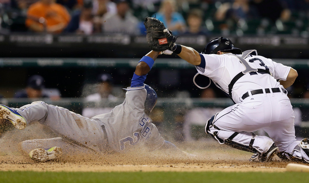 . Detroit Tigers catcher Alex Avila tags Kansas City Royals\' Alcides Escobar as he tries to score from third on a fielder\'s choice during the third inning of a baseball game in Detroit, Wednesday, Sept. 10, 2014. (AP Photo/Carlos Osorio)