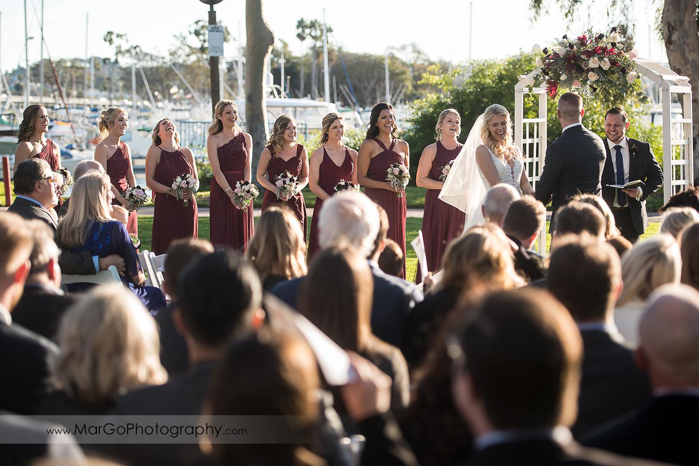 bride and bridesmaids during wedding ceremony at San Diego Marina Village
