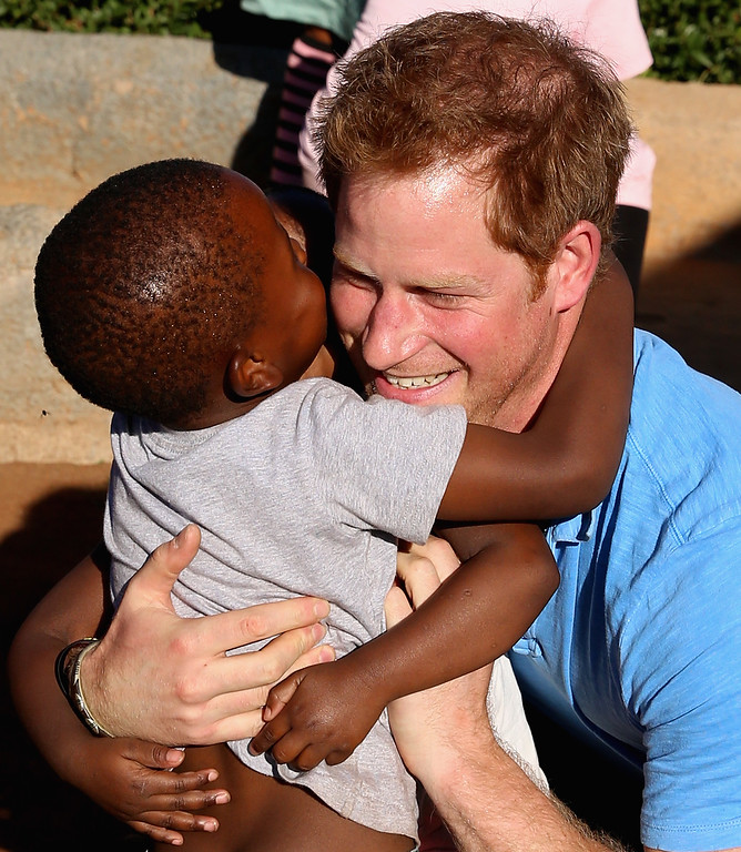 . Prince Harry plays orphan children during a visit to Phelisanong Children\'s Home on December 6, 2014 in Pitseng, Lesotho. Prince Harry was visiting Lesotho to see the work of his charity Sentebale. (Photo by Chris Jackson/Getty Images for Sentebale)