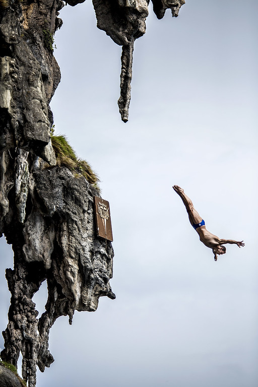 . In this handout image provided by Red Bull, Michal Navratil of the Czech Republic dives from a 25 meter rock at Viking Caves in the Andaman Sea during competition on the fifth day of the final stop of the 2013 Red Bull Cliff Diving World Series on October 24, 2013 at Phi Phi Island, Thailand. (Photo by Dean Treml/Red Bull via Getty Images)