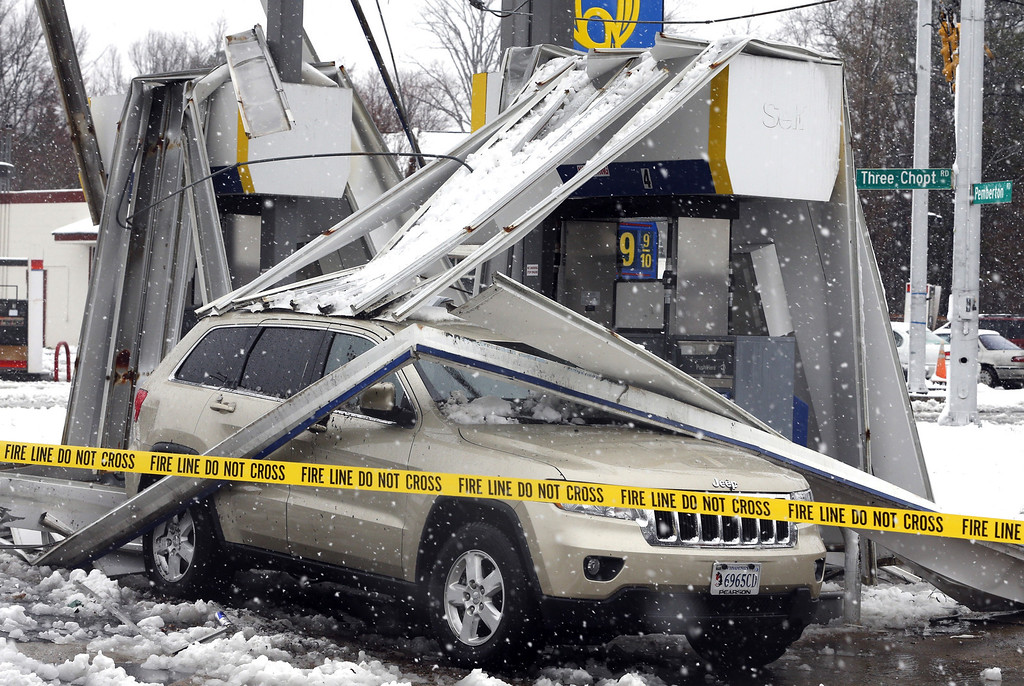. Gusting winds and a heavy wet snow combined to bring down the canopy over gas pumps at a station  in Henrico County, in suburban Richmond, Va. on Wednesday, March 6, 2013. The Richmond area dodged much of the late season storm while the western part of Virginia reporter up to 15 inches of snow. (AP PHOTO/ The Richmond Times-Dispatch, Joe Mahoney)