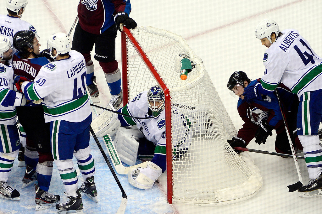 . DENVER, CO - MARCH 24: Cory Schneider (35) of the Vancouver Canucks stops the puck against the Colorado Avalanche during the second period of action. Colorado Avalanche versus the Vancouver Canucks at the Pepsi Center. (Photo by AAron Ontiveroz/The Denver Post)