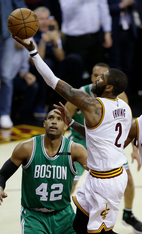 . Cleveland Cavaliers\' Kyrie Irving (2) shoots against Boston Celtics\' Al Horford (42), from Dominican Republic, during the second half of Game 4 of the NBA basketball Eastern Conference finals, Tuesday, May 23, 2017, in Cleveland. The Cavaliers won 112-99. (AP Photo/Tony Dejak)