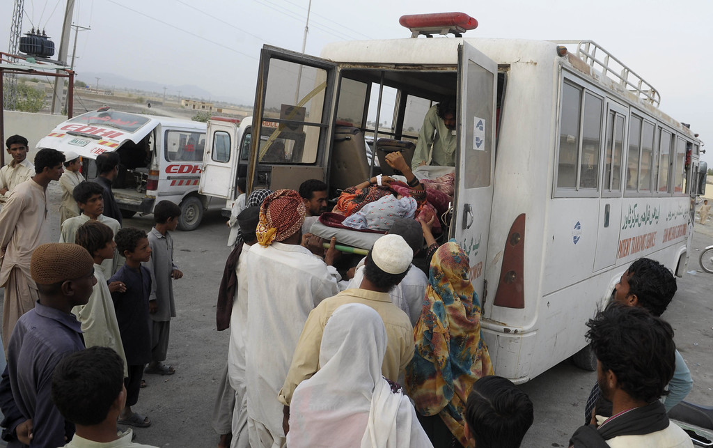 . Pakistani earthquake survivors shift an injured woman into an ambulance at a hospital in the devastated district of Awaran on September 28, 2013. A powerful 6.8-magnitude earthquake hit southwest Pakistan, killing at least 22 people in a region already devastated by a tremor which left more than 300 people dead this week, local officials said. BANARAS KHAN/AFP/Getty Images