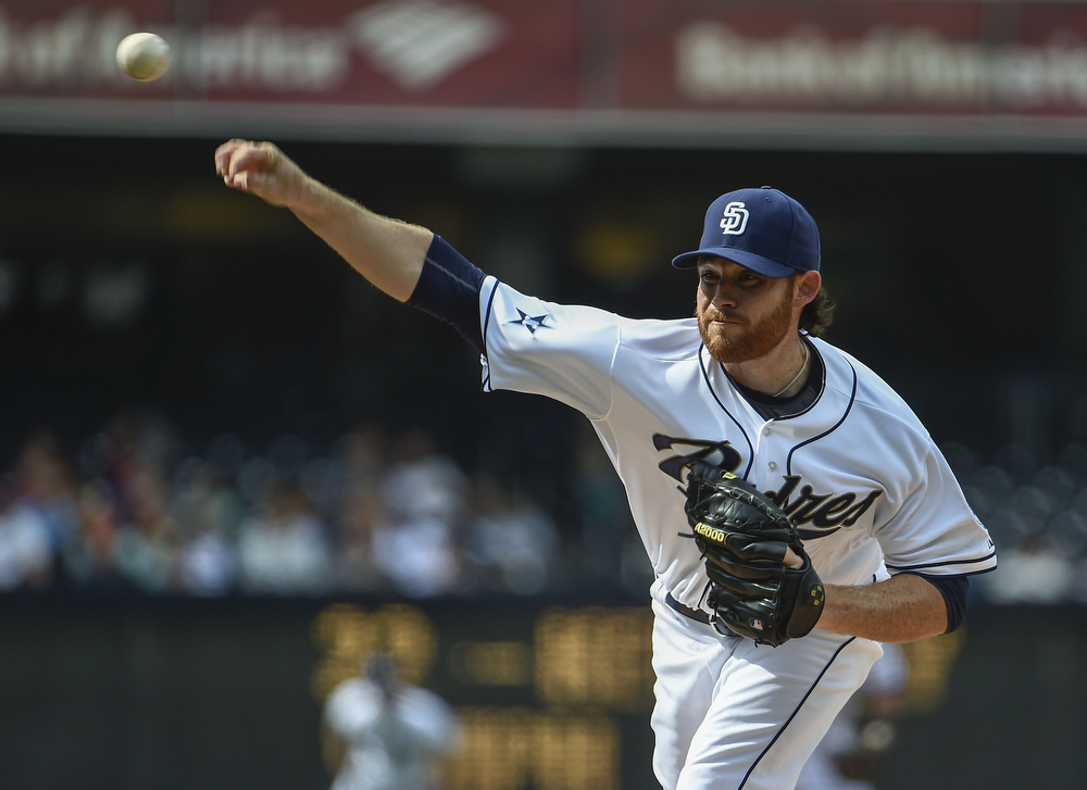 . Ian Kennedy #22 of the San Diego Padres pitches during the first inning of a  baseball game against the Colorado Rockies at Petco Park April 17, 2014 in San Diego, California.  (Photo by Denis Poroy/Getty Images)