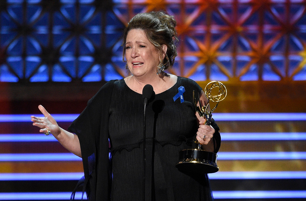 """. Ann Dowd accepts the award for outstanding supporting actress in a drama series for \""""The Handmaid\'s Tale\"""" at the 69th Primetime Emmy Awards on Sunday, Sept. 17, 2017, at the Microsoft Theater in Los Angeles. (Photo by Chris Pizzello/Invision/AP)"""