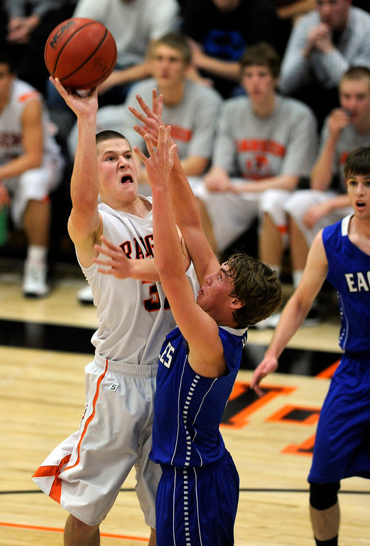 . Rangers guard Chase Stone (33) lifted the ball past Broomfield defender Chad Jukkala (0) in the second half. The Lewis-Palmer High School boy\'s basketball team defeated Broomfield 75-53 Friday night, December 7, 2012.  Karl Gehring/The Denver Post