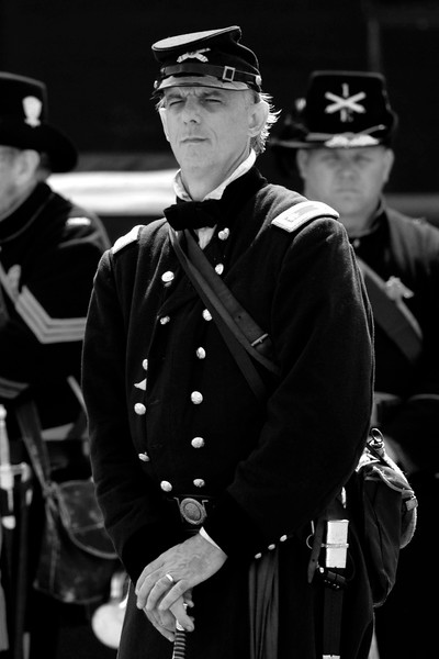 Reenactor Silas Tacket, portraying Major Anderson, stands in front of his men at Ft. Sumter during a reenactment of the surrender ceremony in Charleston, South Carolina on Thursday, April 14, 2011. ..The 150th Anniversary of the Firing on Ft. Sumter was commemorated with lectures, performances, demonstrations, and a living history throughout the area on James Island, Charleston, Mt. Pleasant, and Sullivan's Island during the week from April 8-14, 2011. Photo Copyright 2011 Jason Barnette