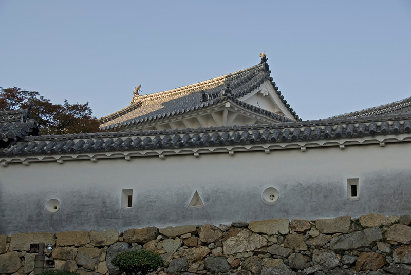 Differently shaped wall openings at Himeji Castle in Japan