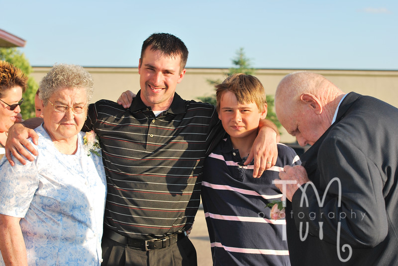 Grandma, Todd, Cody and Grandpa...he was trying to take his flower off...