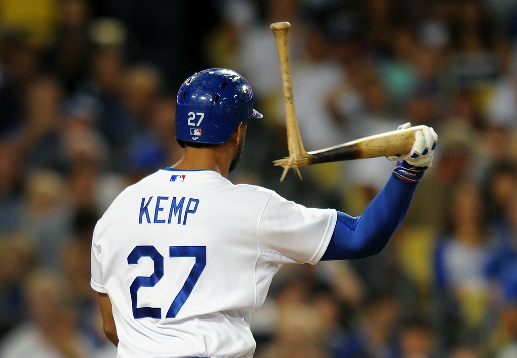 . The Dodgers\' Matt Kemp tosses his bat after breaking it over his knee after striking out to end the fifth inning, Friday, July 11, 2014, at Dodger Stadium. (Photo by Michael Owen Baker/Los Angeles Daily News)