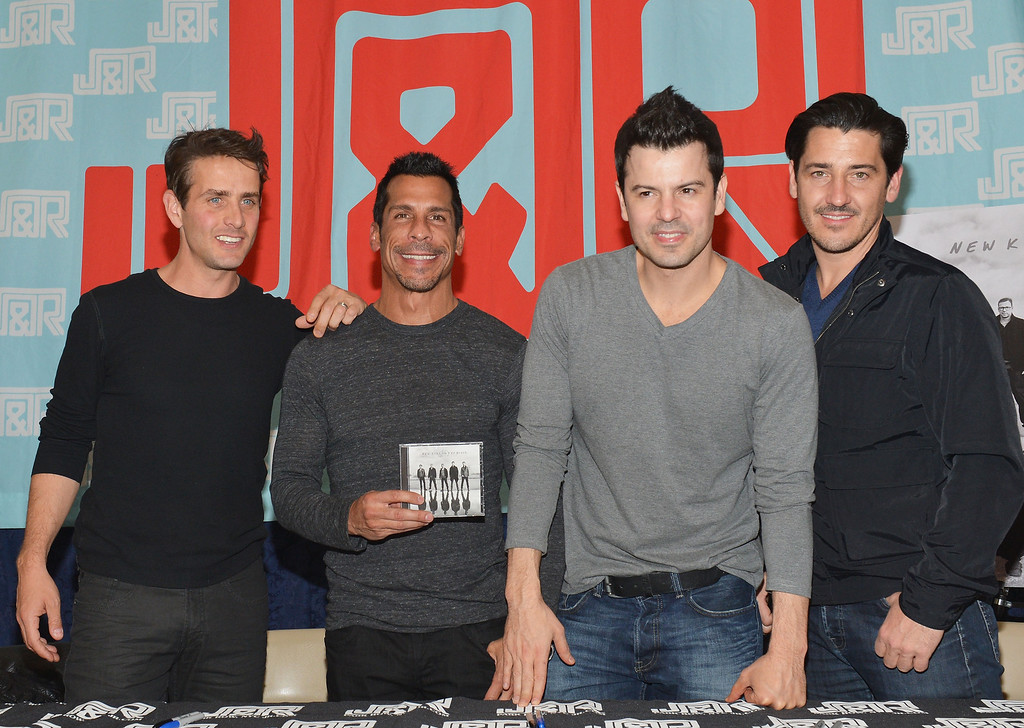 . NEW YORK, NY - APRIL 02:  (L-R) Singers Joey McIntyre, Danny Wood, Jordan Knight and Jonathan Knight of New Kids on the Block attend the New Kids on the Block fan meet and greet at J&R Music World on April 2, 2013 in New York City.  (Photo by Slaven Vlasic/Getty Images)