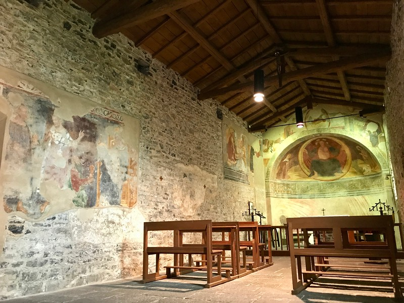 The interior of Chiesa (Church) of San Giovanni Battista - the side walls are decorated with 14th century frescos