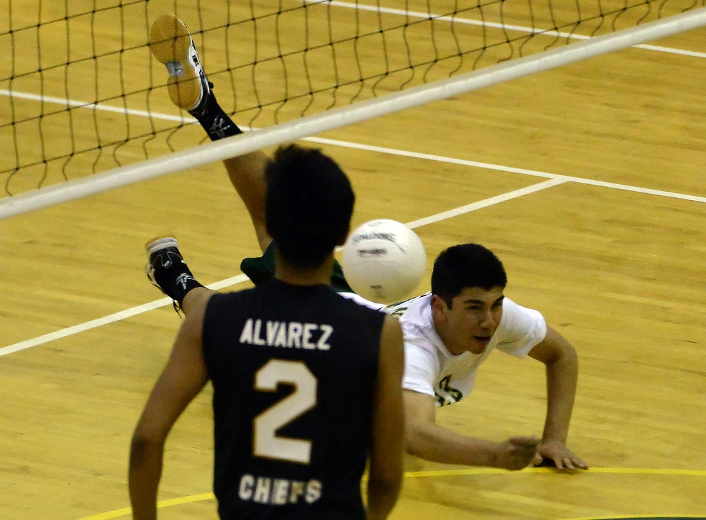 . Damien\'s Daniel Enriquez dives for a shot as Santa Fe\'s Carlos Alvarez (2) looks on in the second game of a prep volleyball match at Damien High School in La Verne, Calif., on Wednesday, May 20, 2015. Damien won 25-17, 25-19, 29-27. (Photo by Keith Birmingham/ Pasadena Star-News)