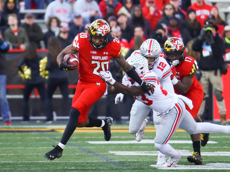 Maryland RB #20 Javon Leake sheds a tackle by Ohio State S #23 Jahsen Wint