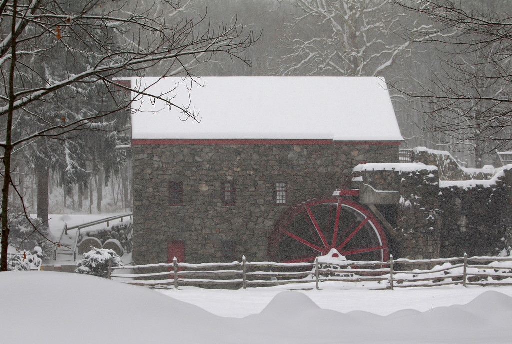 . Snow blankets a grist mill at Longfellow\'s Wayside Inn Wednesday, Feb. 5, 2014, in Sudbury, Mass. Up to a foot of snow was predicted throughout the day in some parts of Massachusetts.   (AP Photo/Bill Sikes)