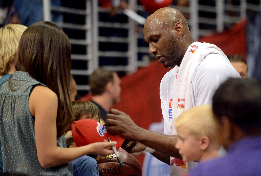 . Lamar Odom of the Los Angeles Clippers signs autographs prior to the start of their game against the Cleveland Cavaliers Monday, November 5, 2012 at the Staples Center in Los Angeles, CA.  (Andy Holzman/Los Angeles Daily News)