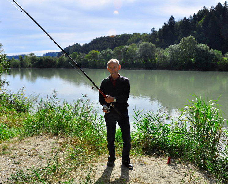 friendly fisherman on river's edge