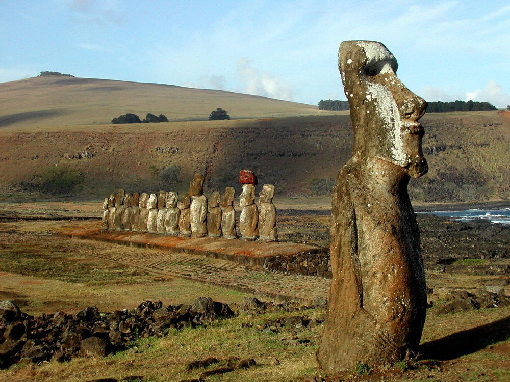 """. Easter island, CHILE:  View of 15 Moais (L), arranged on a perfect line over a 100 meters platform, placed in the \""""Ahu Tongarki\"""" sector of the Chilean Easter Island 13 July 2006. The island received 14 July 2006 about ten monuments of these place restored in Japan during four years of work, with the cooperation of the UNESCO.   HO/AFP/Getty Images"""