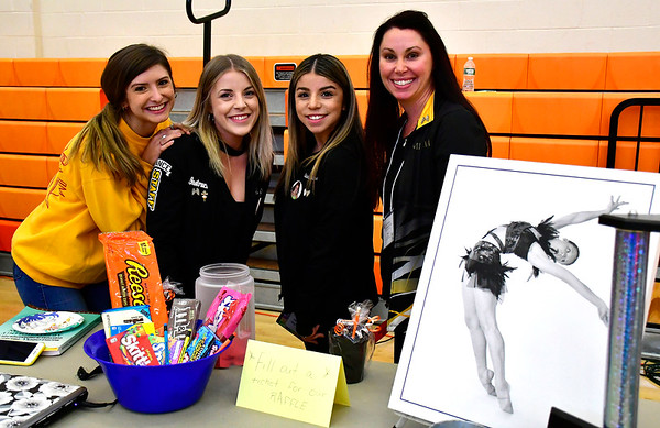 5/3/2019 Mike Orazzi | Staff Reach for the Stars Academy of Dance's Cara Andrews, Jennah Dionne, Marissa Mendoza and Mary Marrone during the 9th Annual Terryville High School Career Fair on Friday morning.