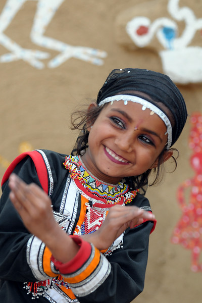 Child artist from Rajki-Puran Nath Sapera & Party, Jaipur photographed at the Suraj Kund Mela 2009 held in Haryana (outskirts of Delhi), North India. The Suraj Kund Mela is an annual fair held near Delhi. Folk dances, handicrafts and a lot of fun.