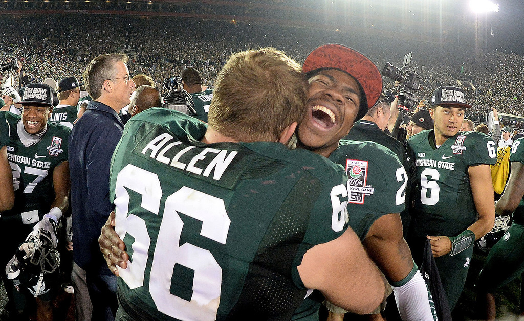 . Michigan State\'s Mark Meyers (29) smiles with teammate Jack Allen (66) after defeating Stanford 24-20 during the 100th Rose bowl game in Pasadena, Calif., on Wednesday, Jan.1, 2014.   (Keith Birmingham Pasadena Star-News)