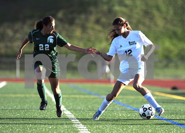 10/18/2017 Mike Orazzi | Staff Maloney's Haley Lespier (22) and Bristol Central's Adalia Malick (12) during soccer in Bristol Wednesday.