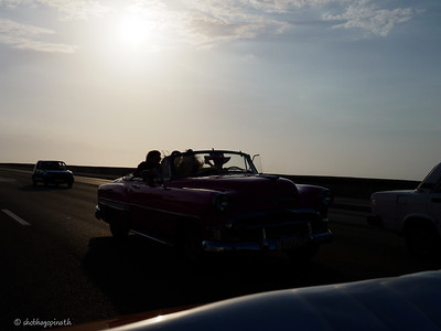 Driving along the Malecón, Havana