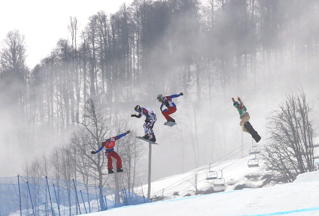 . Gold medalist Pierre Vaultier of France, left, leads, from second left to right, silver medalist Nikolai Olyunin of Russia, Paul�Henri de le Rue of France, and bronze medalist Alex Deibold of the United States, in the men\'s snowboard cross final at the Rosa Khutor Extreme Park, at the 2014 Winter Olympics, Tuesday, Feb. 18, 2014, in Krasnaya Polyana, Russia. (AP Photo/Sergei Grits)
