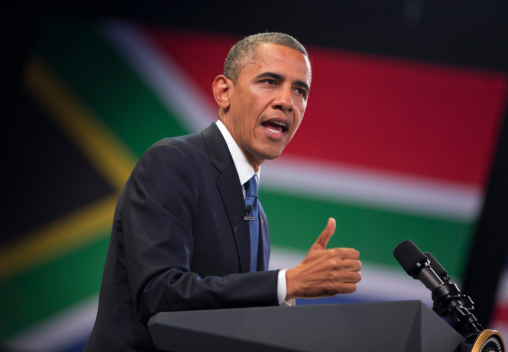 . U.S. President Barack Obama gestures during a town hall meeting with young African leaders at the University of Johannesburg Soweto on Saturday, June 29, 2013, in Johannesburg, South Africa. The president is in South Africa, embarking on the second leg of his three-country African journey. The visit comes at a poignant time, with former South African president and anti-apartheid hero Nelson Mandela ailing in a Johannesburg hospital. (AP Photo/Evan Vucci)