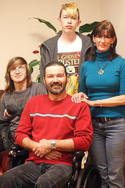 10 02 Last August, Edward DeLee of McDonough was involved in a motorcycle accident which left him confined to a wheelchair. Meet the DeLee family from left: Clinton, Edward, Nicholas Decker and Renee. Alicia Lavender