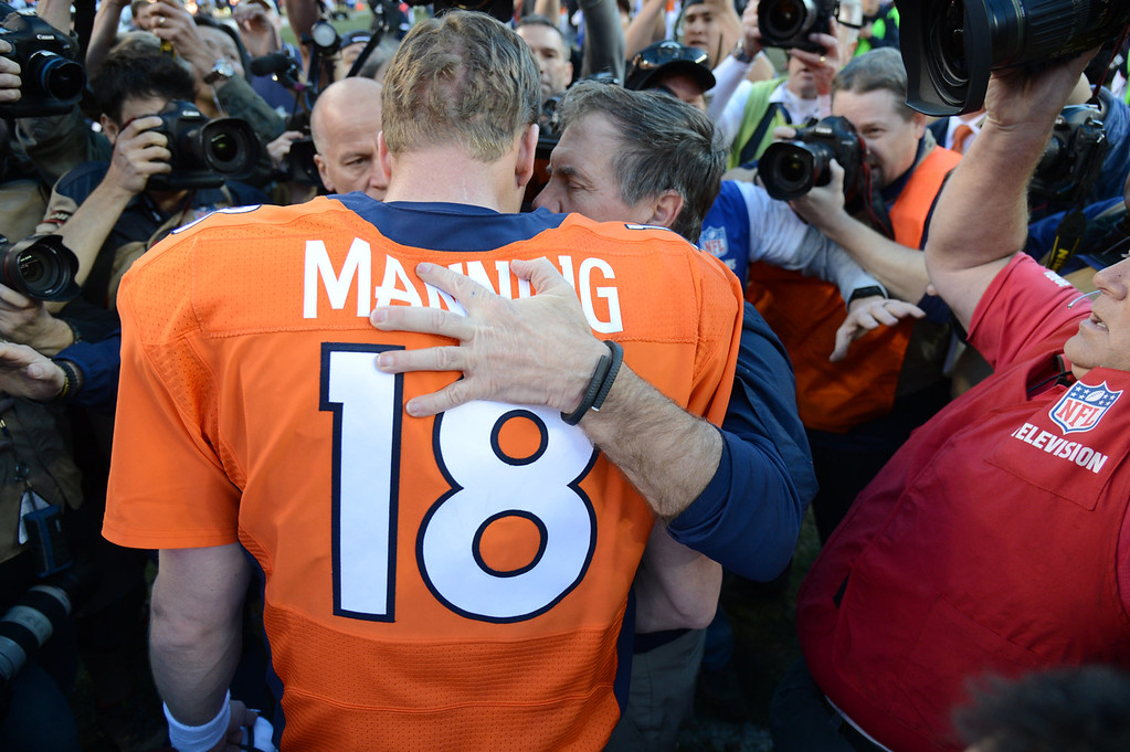 . Denver Broncos quarterback Peyton Manning (18) talks with New England Patriots head coach Bill Belichick after the game. The Denver Broncos take on the New England Patriots in the AFC Championship game at Sports Authority Field at Mile High in Denver on January 19, 2014. (Photo by John Leyba/The Denver Post)