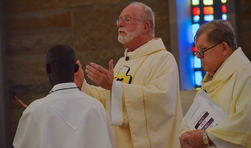 Fr. Ed welcomes everyone