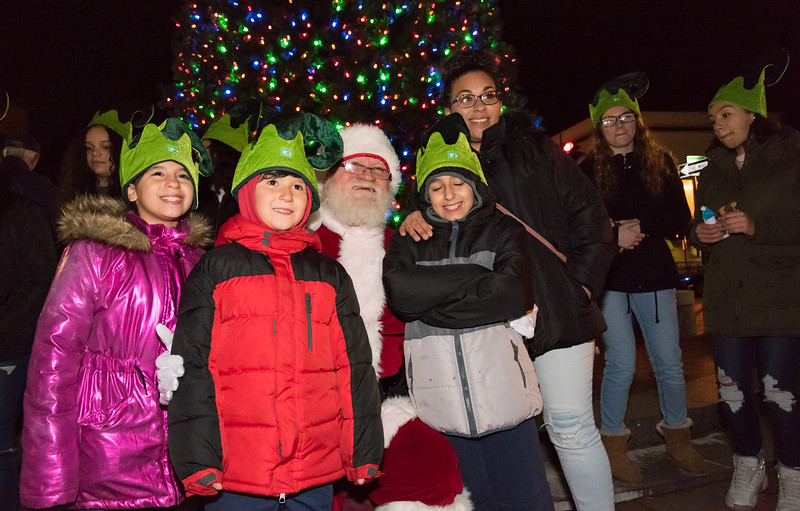 11/29/18  Wesley Bunnell | Staff   New Britain held their tree lighting ceremony with a visit from Santa on Thursday evening at Central Park. Posing for a photo with Santa are Alyssa Filipkowski, age 10, Jordan Filipkowski, age 7, Santa Claus, Joseph Filipkowski, age 11, and their mother Lismary Filipkowski.