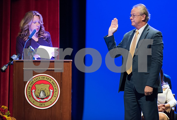 11/14/17 Wesley Bunnell | Staff The inauguration of Mayor Erin E. Stewart and other elected officials was held on Tuesday morning at New Britain High School. Antoinette Spinella, L, swears in the Town and City Clerk Mark H. Bernacki.