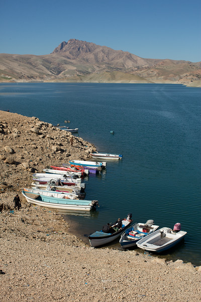 Leisure boats moored on the shores of Lake Dukan in Iraqi Kurdistan.